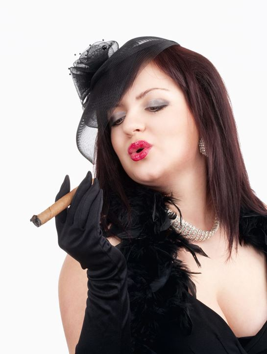 Young Woman with Black Hat and Gloves Smoking Cigar