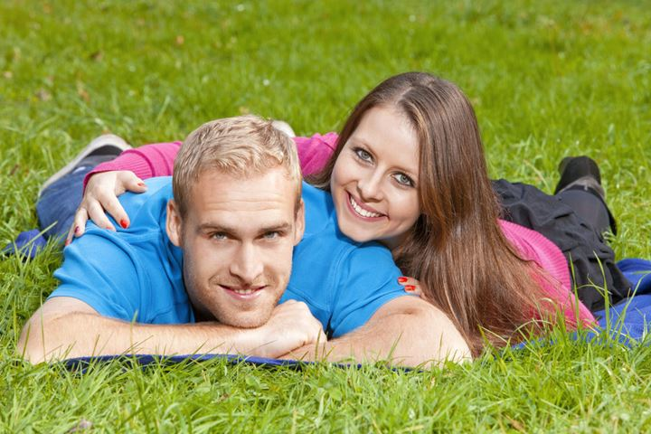 Portrait of a Happy Young Couple in the Park, Smiling.