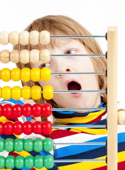 Boy Counting on Colorful Wooden Abacus Yawning - Isolated on White