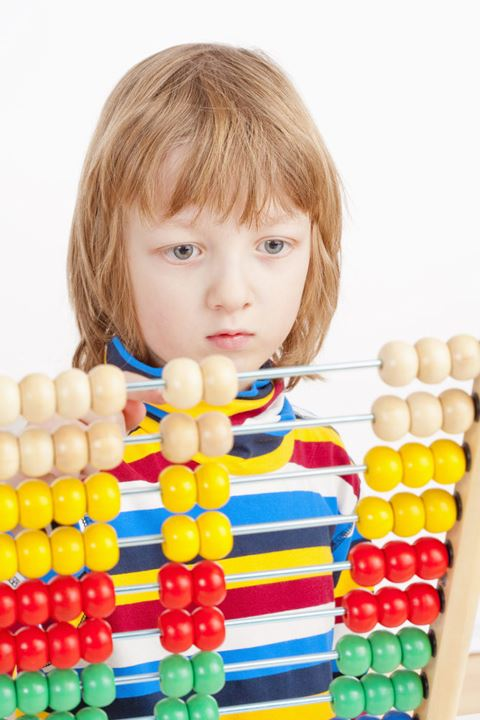 Boy Counting on Colorful Wooden Abacus - Isolated on White