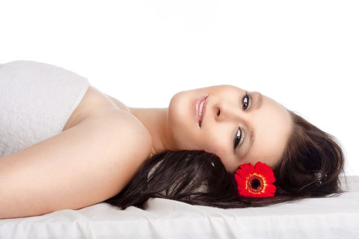 Young Woman Lying on her Back in Spa Relaxing