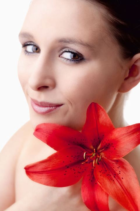 Portrait of a Beautiful Young Woman with Red Lily - Isolated on White