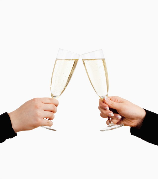 Two Hands Holding Glasses of Champagne Toasting - Isolated on White
