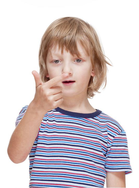 Boy Counting on Fingers of his Hand - Isolated on White