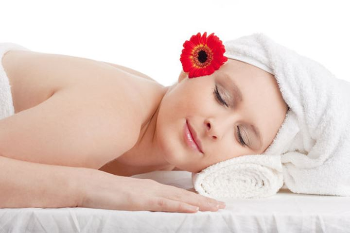 Young Woman in Spa Relaxing with her Eyes Closed
