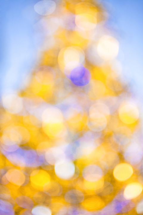 Defocused Ornaments on Traditional Christmas Tree