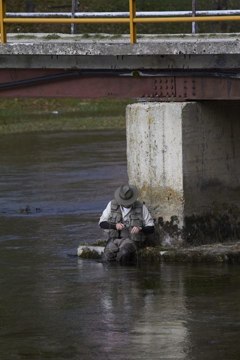 Flyfisherman resting at the bridge.
