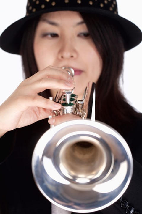 Portrait of a Female Trumpet Player - Isolated on White