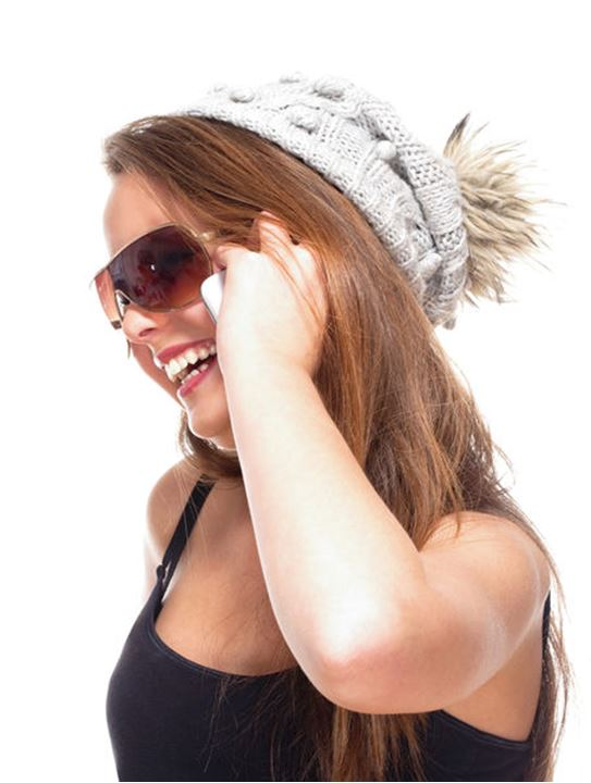 Teenage Girl with Sunglasses on Mobile Phone - Isolated on White