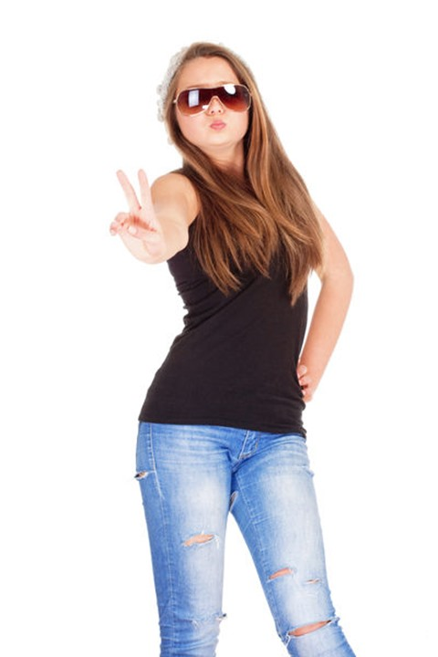 Portrait of a Teenage Girl with Sunglasses showing V-Sign