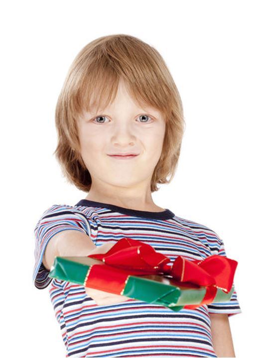 Boy Holding out a Present - Isolated on White