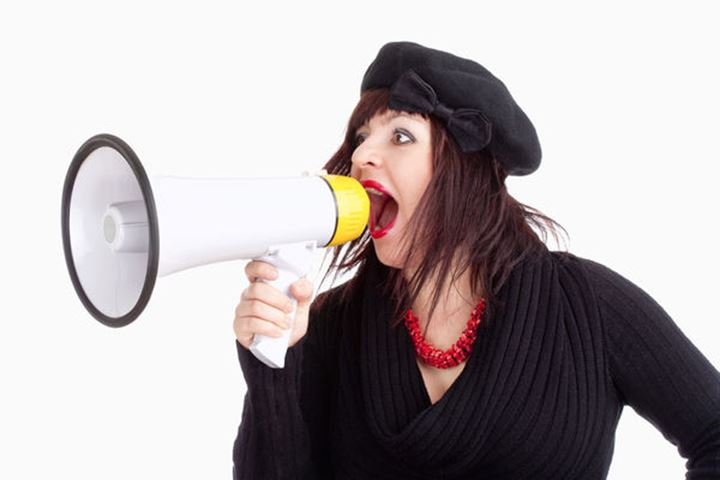 Young Woman with Hat Yelling in Megaphone - Isolated on White