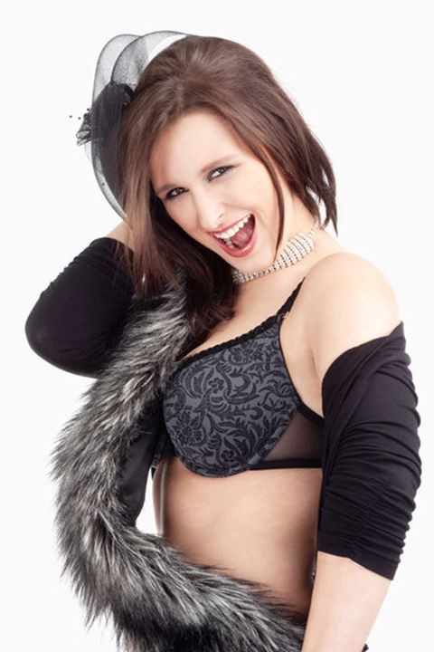 Young Woman with Hat and Fur in her Bra, Smiling - Isolated on White