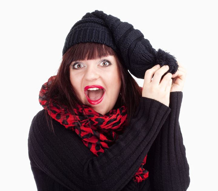 Surprised Woman in Black Cap and Red Scarf - Isolated on White