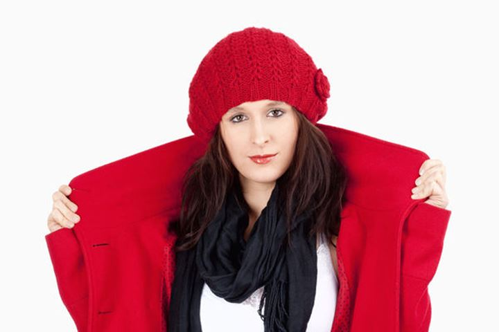 Young Woman in Red Coat and Cap - Isolated on White