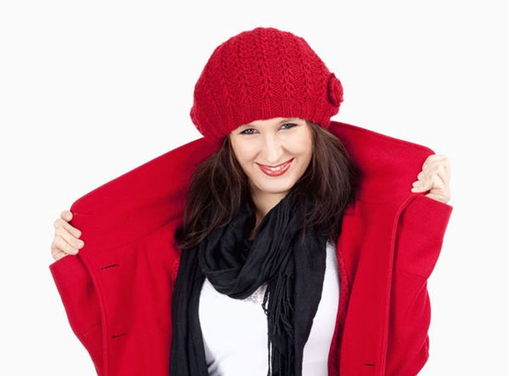 Young Woman in Red Coat and Cap Smiling - Isolated on White