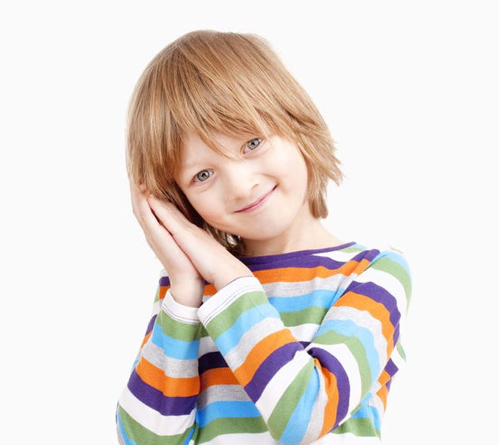 Portrait of a Boy in Colorful Shirt with Head on his Hands - Isolated on White