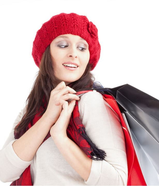Young Woman in Red Cap with Shopping Bags  - Isolated on White