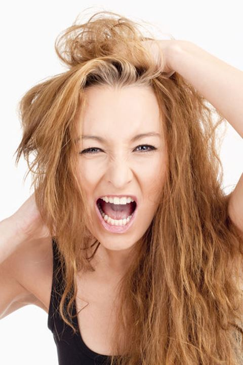 Frustrated Girl with Long Brown Hair Screaming - Isolated on Gray