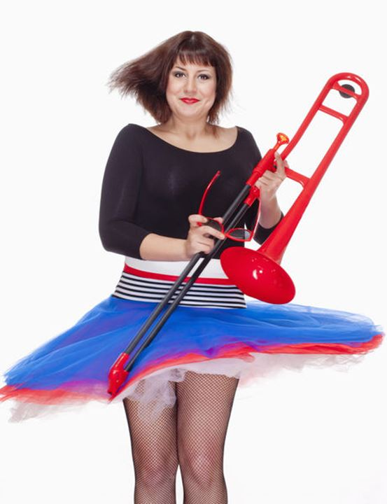 Young Female Musician with Red Trombone Dancing - Isolated on White