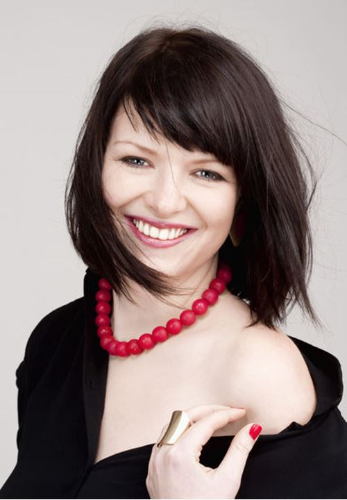 Portrait of a Young Beautiful Woman with Dark Brown Hair Smiling