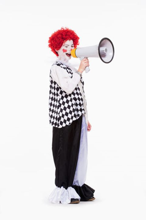 Little Clown in Red Wig and Makeup Using Megaphone.