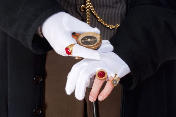 Closeup of Magician Hands with Gloves and Rings