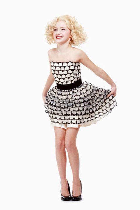 Young Girl with Blond Wig Posing as Marylin Monroe