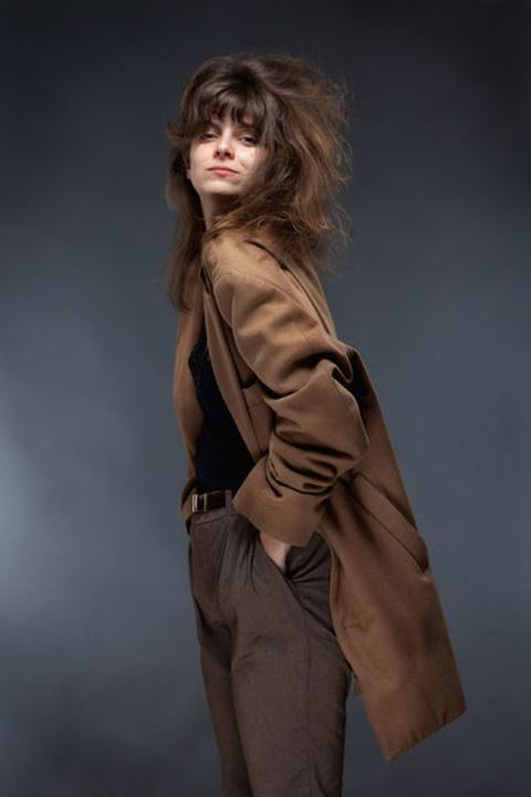 Portrait of a Young Woman in Brown Coat