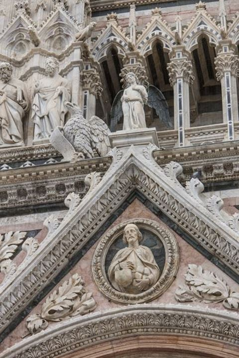 Detail of the facade of the Cathedral of Siena, Italy