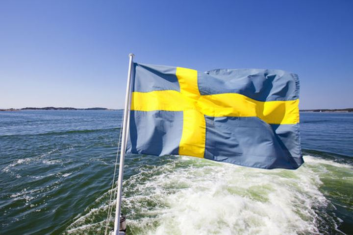 Sweden, Stockholm Archipelago - Swedish Flag on a Ferry