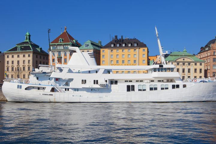 Sweden, Stockholm, The Old Town - Boats moored along the quayside.