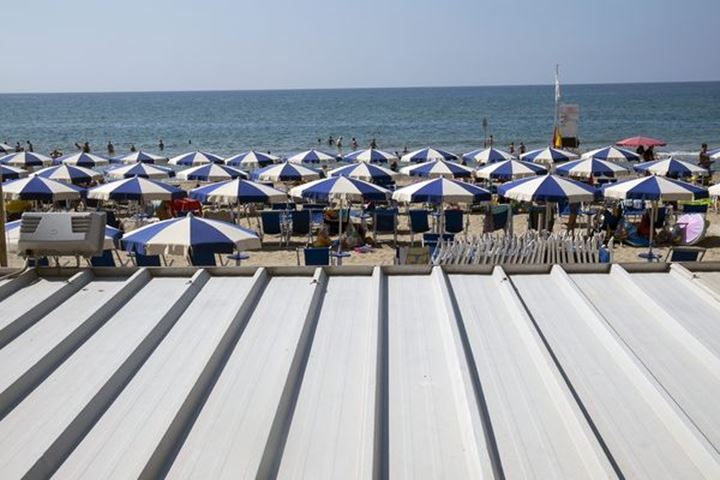 Parasols at the beach in Terracina, Italy