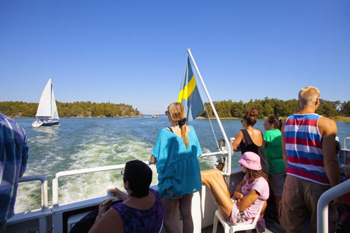 Stockholm Archipelago - Passengers on ferry watching boats.