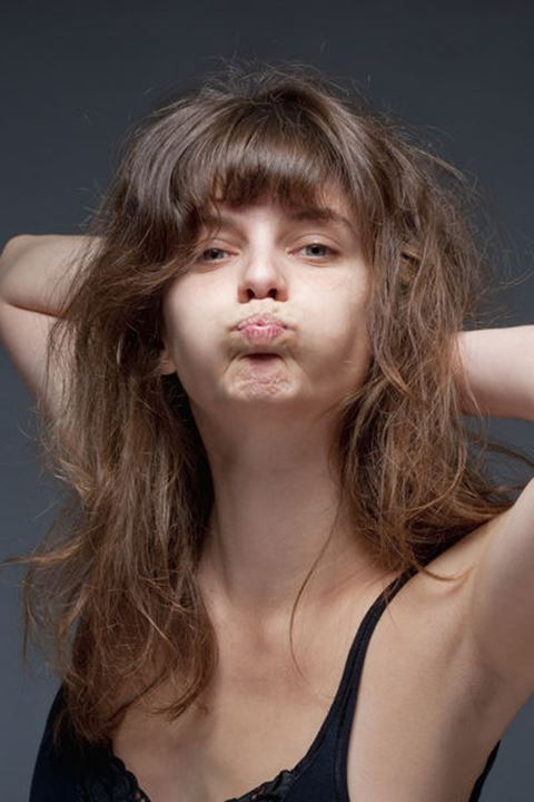 Portrait of a Young Woman with Brown Hair Making a Face