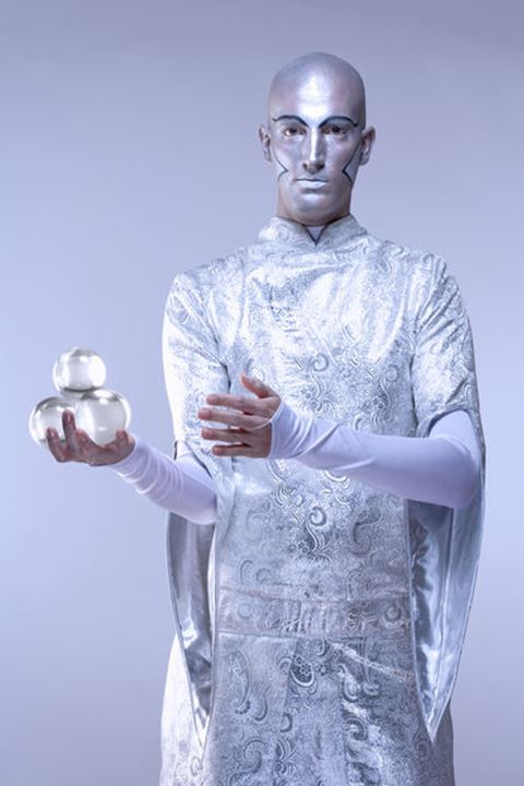 Magician with Glass Balls in Stage Makeup and Costume
