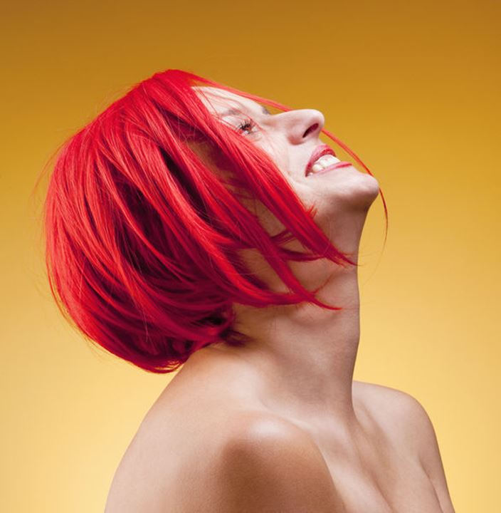 Portrait of a Young Woman in Red Wig