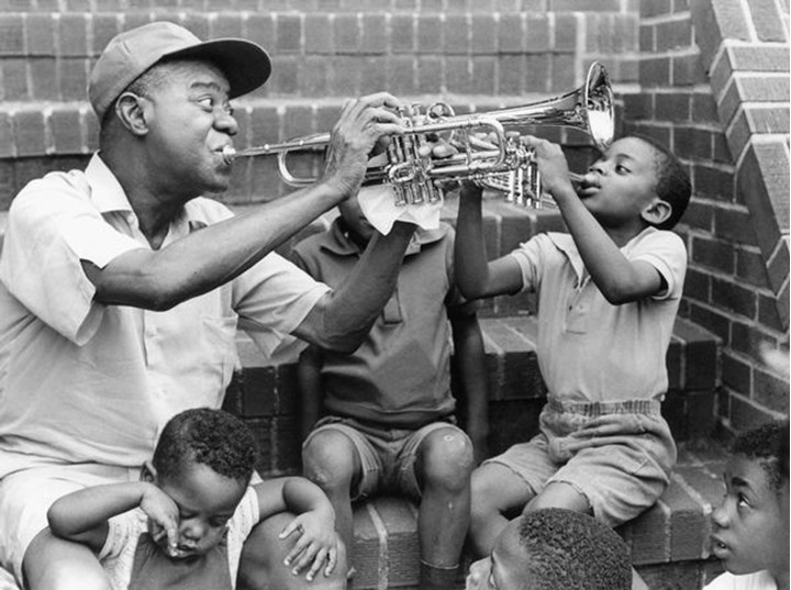 Louis Armstrong, American jazz trumpeter and singer, holding an impromptu performance on the steps of his home in Queens, London Island, in 1970.