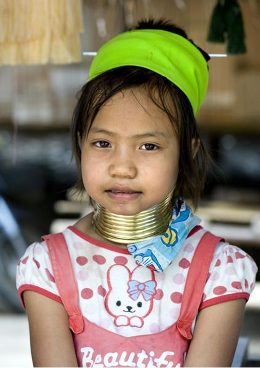 A little girl from the long neck village, hill tribes of northern Thailand