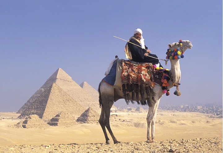 Egypt Giza Pyramids - man on camel.