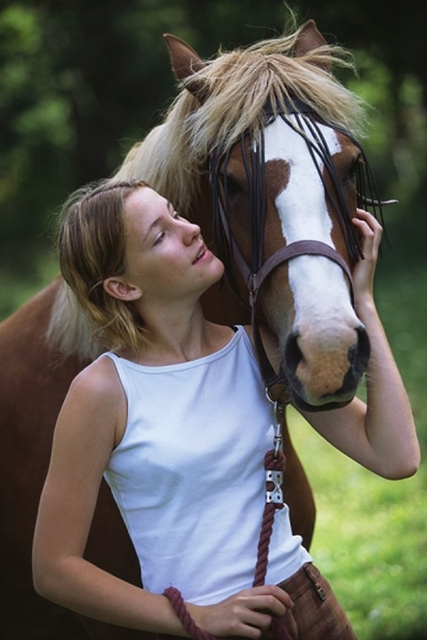 Young woman with her horse,