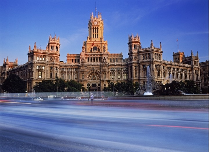 Plaza de Cibeles with passing traffic in Madrid