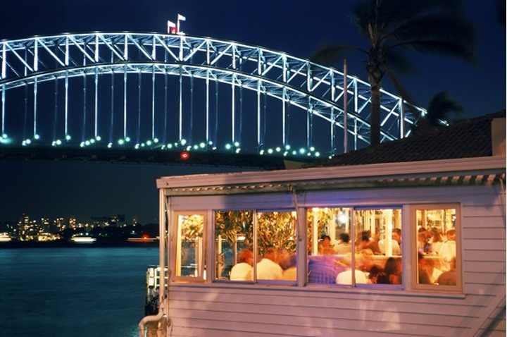Sails restaurant at McMahons Point on Lavender Bay in North Sydney with Harbor Bridge at night