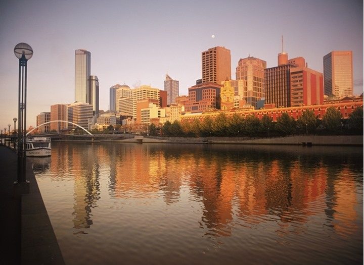 Central Business District reflecting off Yarra River in Melbourne at sunrise