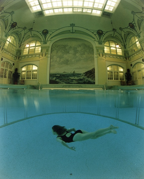 Lady diver in an artistic indoor pool