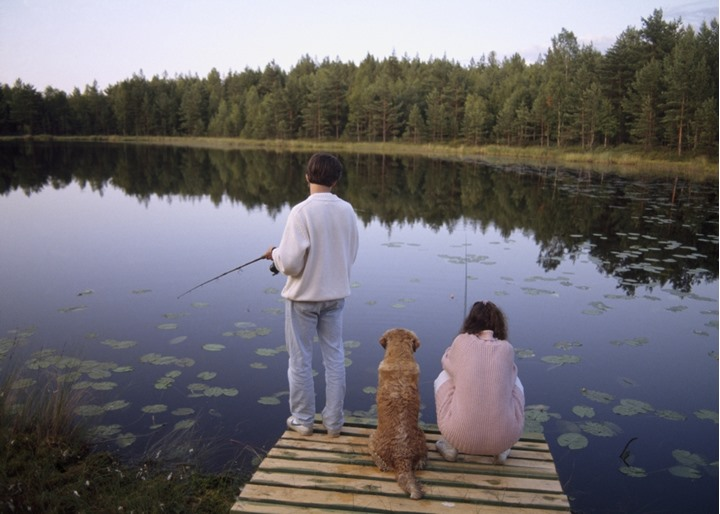 A man, a woman and a dog fishing