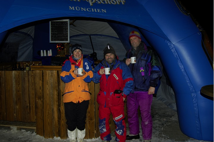 Three people drinking warm drinks in Munich in winter